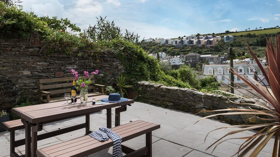 Enjoy a morning cuppa or an evening glass of wine on the terrace overlooking the village.