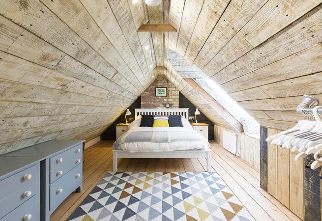 Top attic room has sea glimpses across the roof tops.