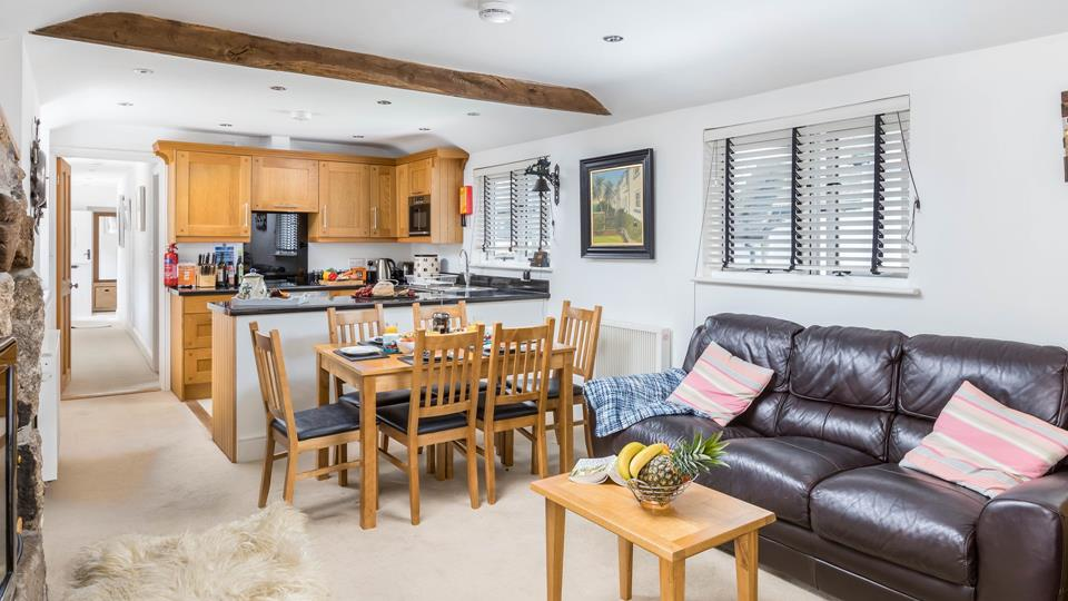The open plan kitchen/dining area is perfect for families
