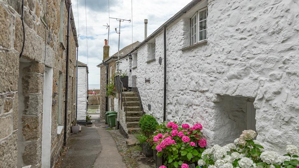 The pretty traditional cottage is only a few seconds walk from the harbour.