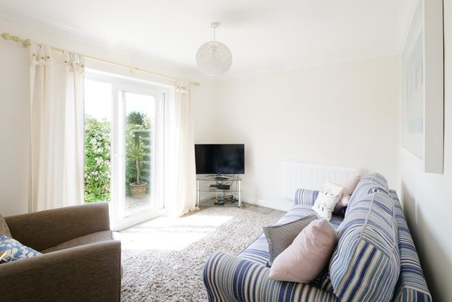Sitting room has patio doors leading to the private garden area