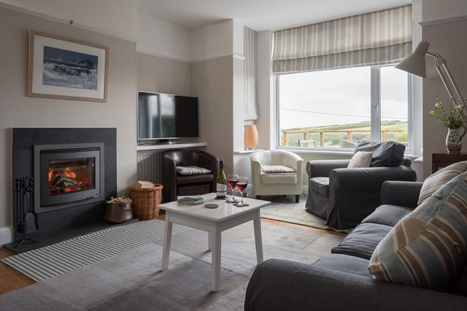 The cosy sitting area with woodburner at the front of the house.