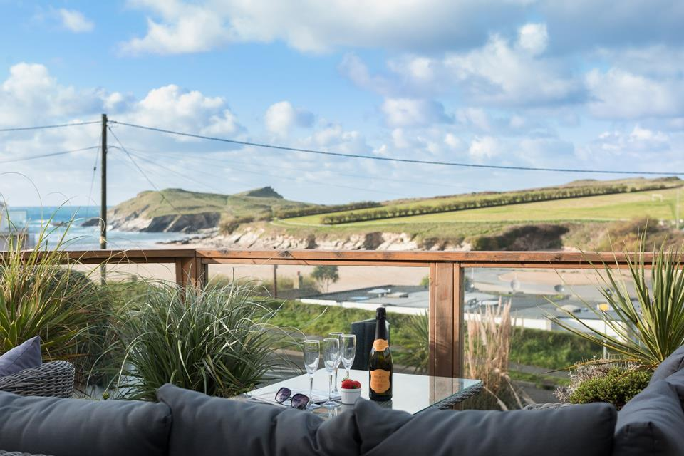 The sun deck has views of Porth beach and the stunning headland that surrounds it.