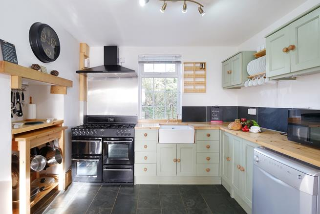 Farmhouse style kitchen with Belfast sink and stone flooring