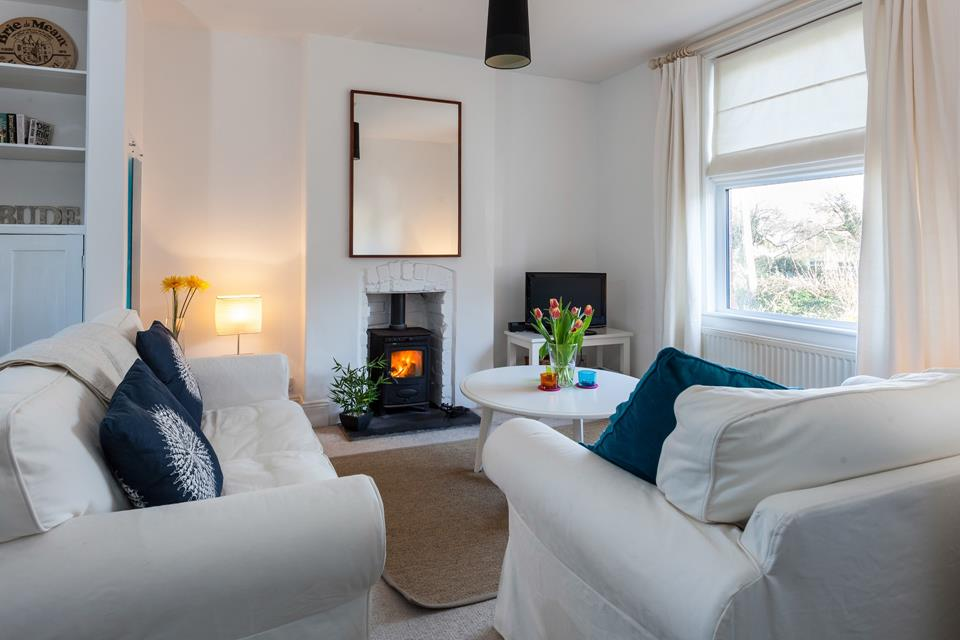 Open plan sitting/dining area with woodburner for cosy nights in.