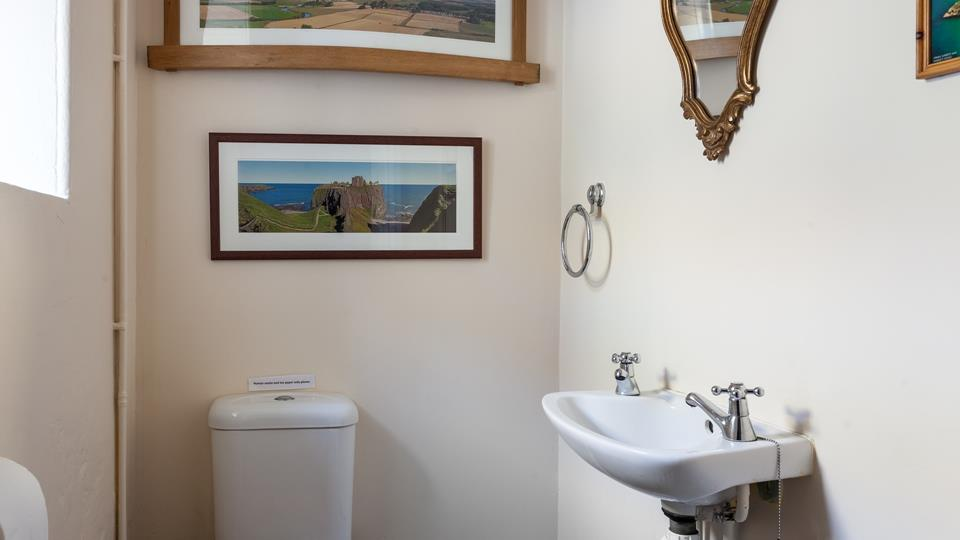 The property benefits from a handy cloakroom, ideal for washing hands before dinner.
