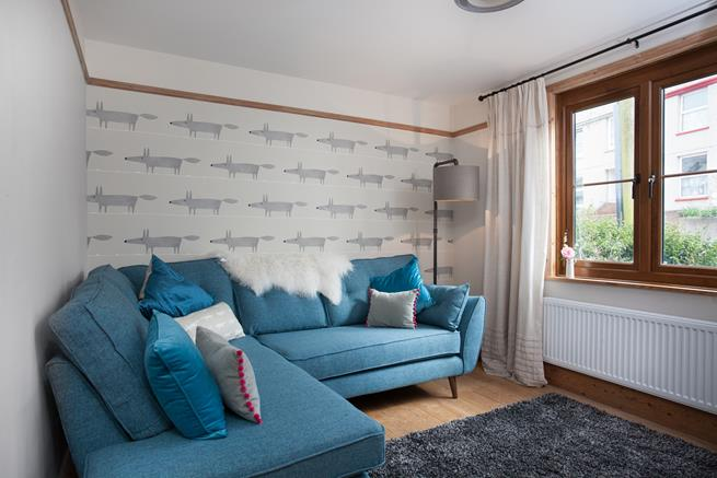 Snug and cosy family room with a wonderfully cosy corner sofa to sink into and chill out