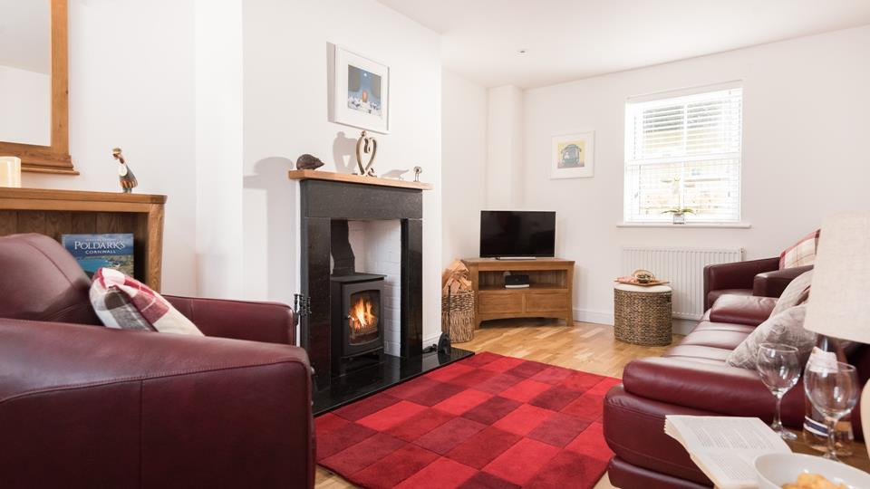 The lounge offers ample space for the whole family, ideal for snuggling up for family movie nights!