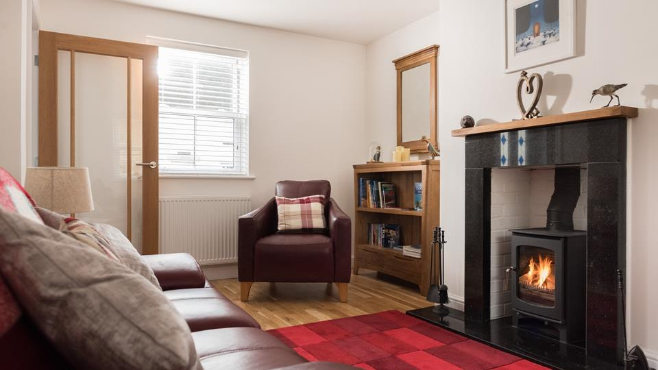 The cosy sitting room with welcoming woodburner is fabulous for relaxing after a busy day.