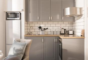 The kitchen has a fresh, modern feel which provides the perfect space for cooking.