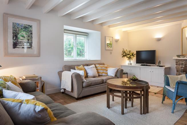 The spacious sitting room has plenty of seating for everyone to relax and unwind together.