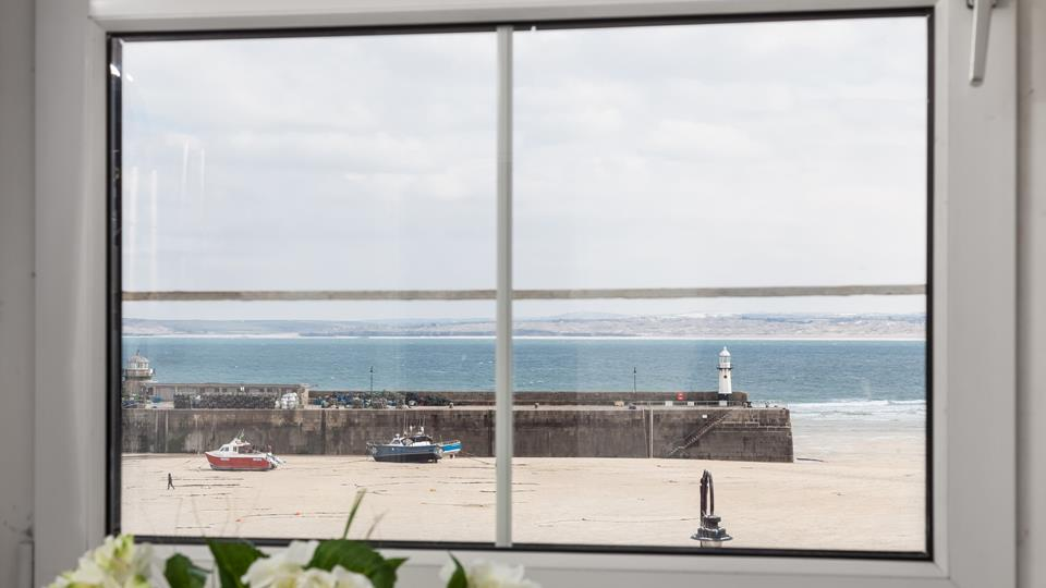 Enjoy a beautiful view out towards Smeaton's Pier and Cornwall's rugged coastline disappearing in the distance.