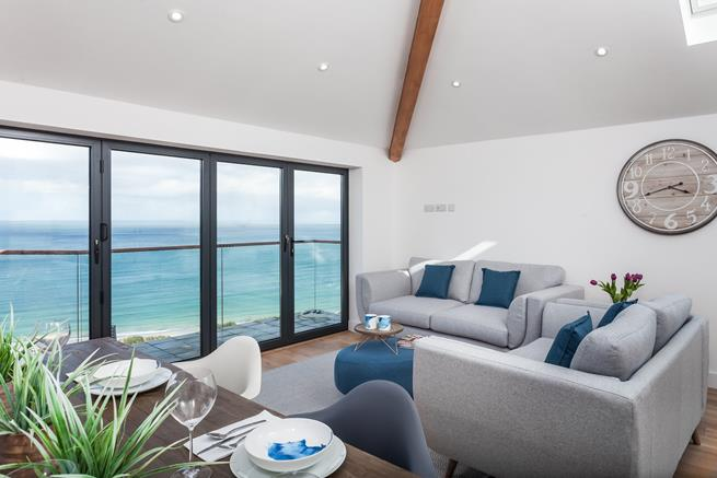 Relax in the sitting room overlooking the beautiful bay.