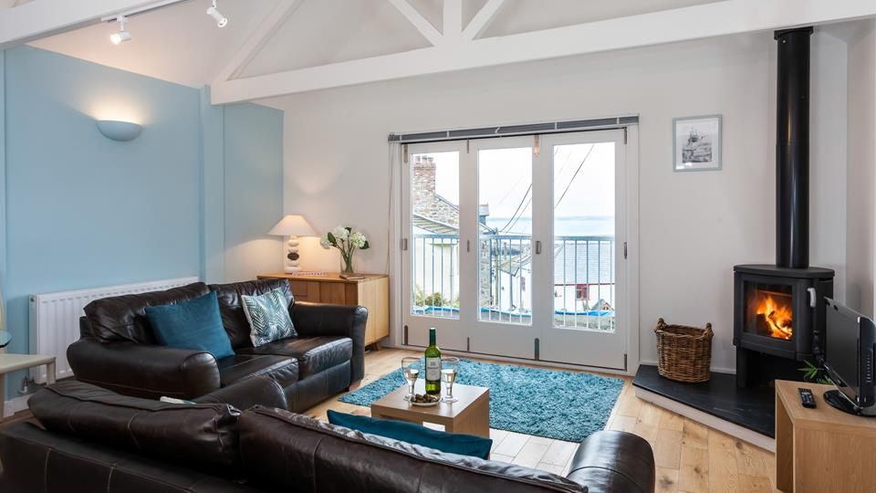A stunning light filled room with a sea view and woodburner for the cooler months.