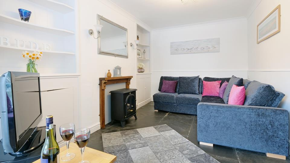 Enjoy your favourite tipple in the sitting room which has great character, Smart TV for some great entertainment.