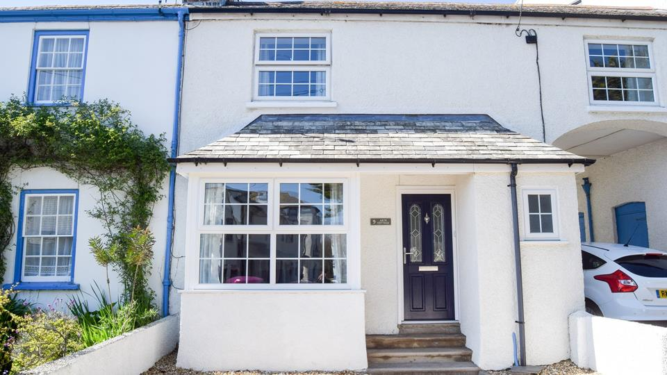 Arch Cottage is tastefully presented on the outside with its noticeable arch over the driveway.