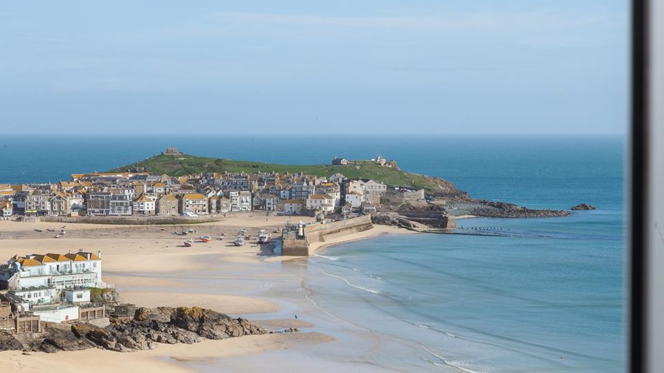 A panoramic view over St Ives Harbour, town and beach which has always got something to watch all day long.