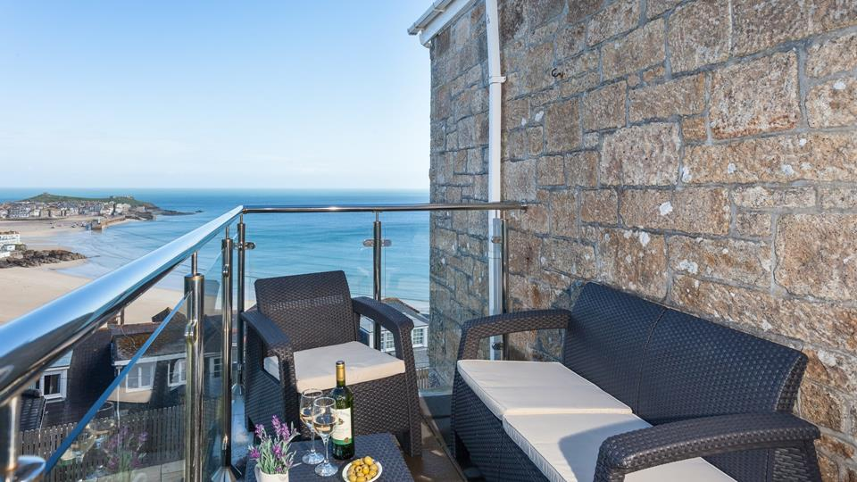 A beautiful sea view across St Ives Harbour and beach from the glass and steel balustrade balcony.