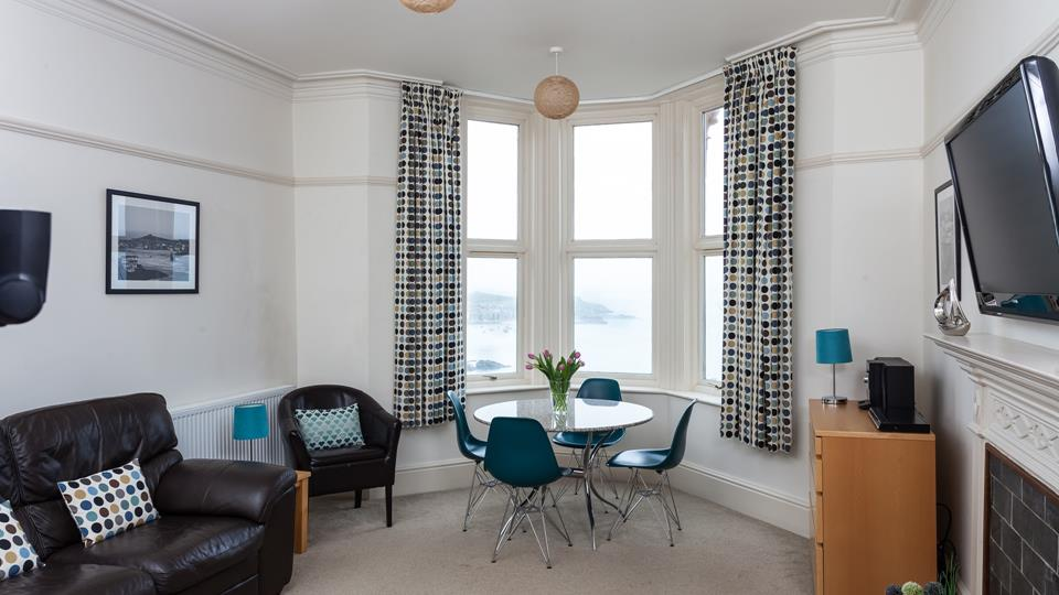 The sitting room area has a full bay window which has a stunning sea view over St Ives.