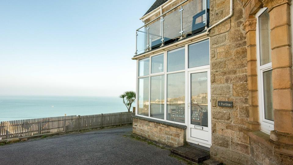 There is parking space on the tarmac driveway with a stunning view across St Ives bay.