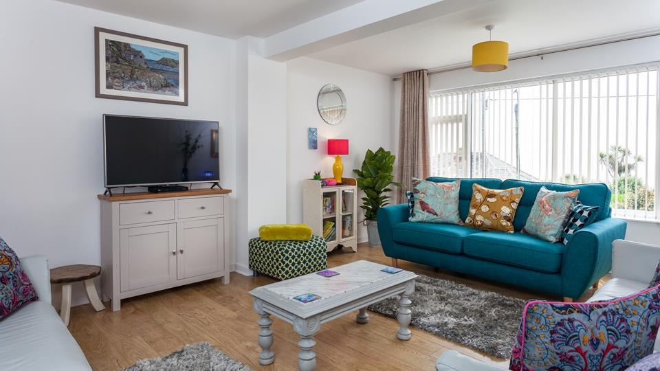 Cosy with sea views, the lounge is the perfect space to gather your family for a movie night over a takeaway!
