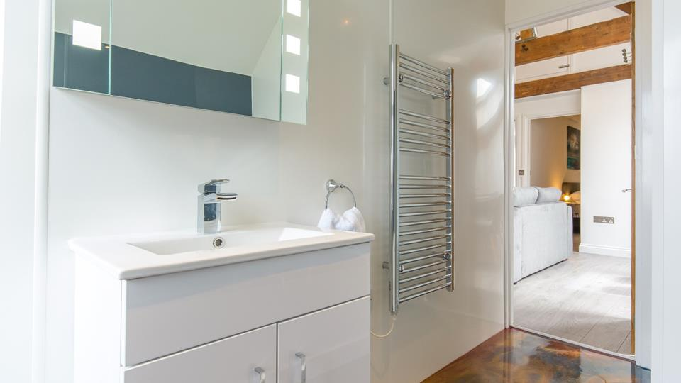 Superbly spacious family bathroom with a good-sized bath, heated towel rail, enclosed shower and a fantastic floor!