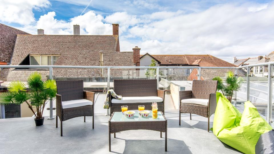 Roof terrace accessed from the living area has a lovely rattan table and chairs with outdoor bean bags for relaxing in the great outdoors.