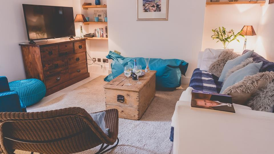 The living room has a modern rustic theme.