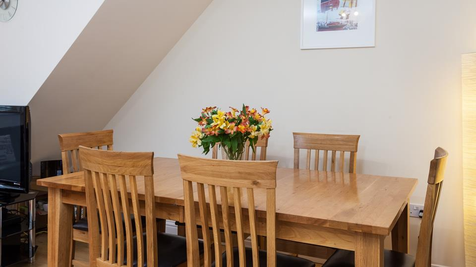 Dining table with chairs for 6 people.
