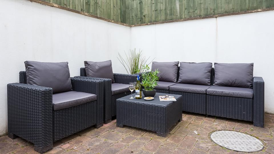 An enclosed patio area at the rear of the property is the perfect space for some al fresco dining.