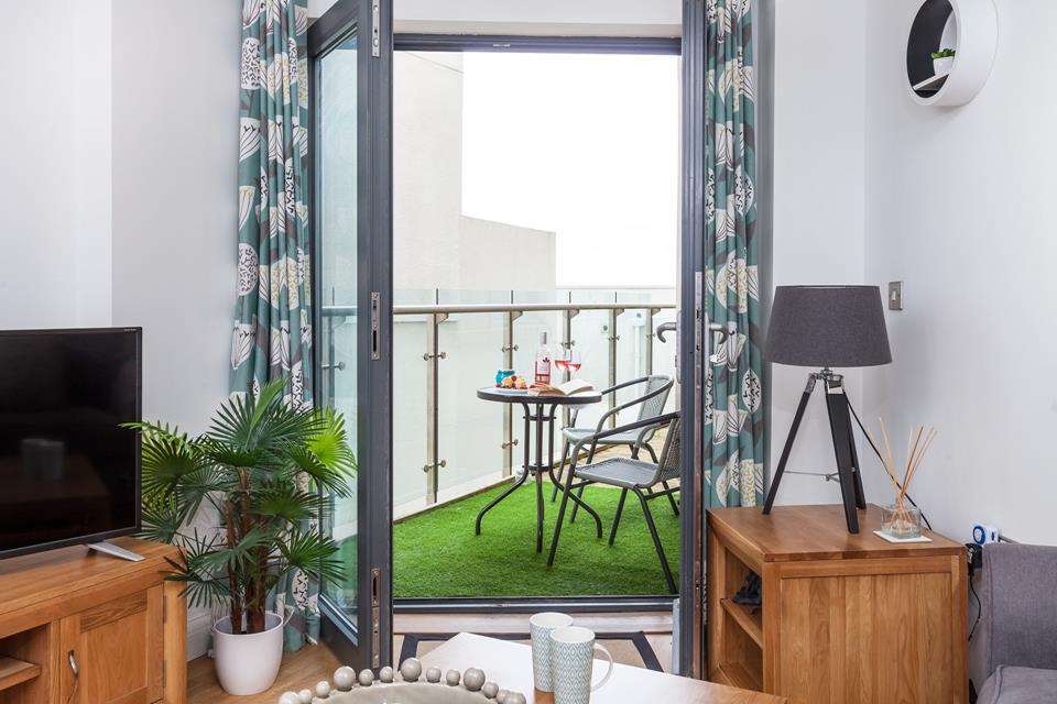 You can step out onto the balcony for a cup of tea in the morning, with the added comfort of faux turf under your feet.
