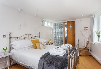 Sumptuous king size bed with en suite shower room.