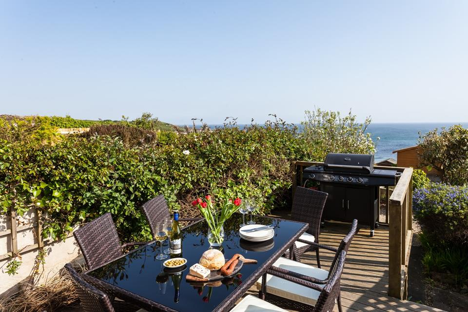 Enjoy al fresco dining on the decked area with stunning surroundings.