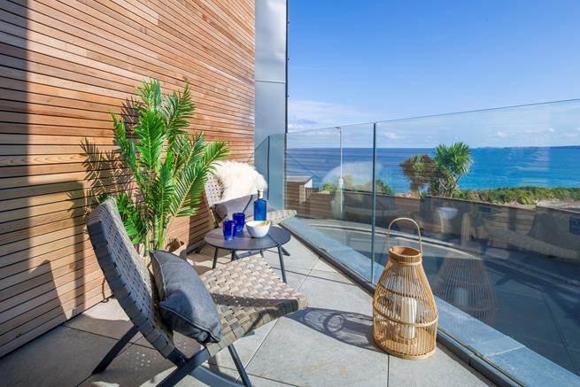 The balcony from the living area has lovely views of the north coast.