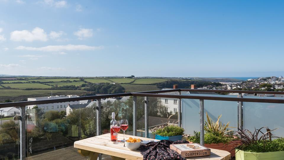 With far reaching views towards Crantock over the rooftops from the roof terrace.