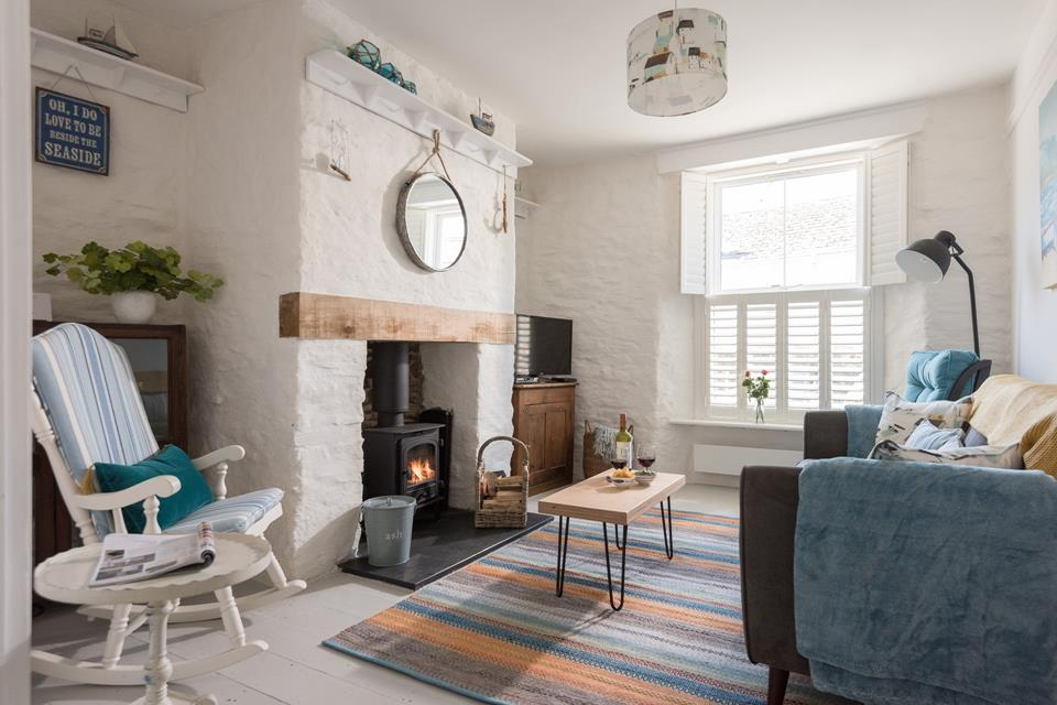 Living room with cosy wood burner.