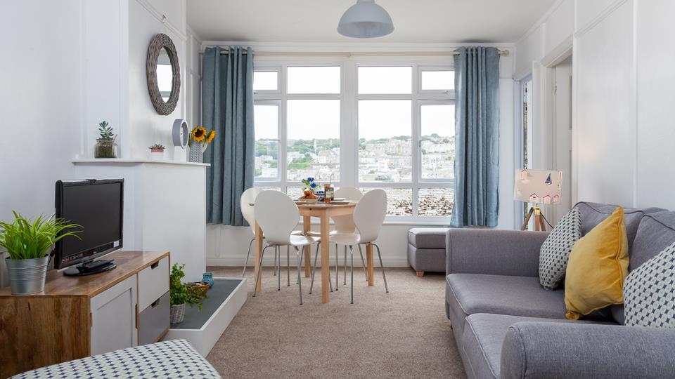 Relax in this cosy living room with views over the rooftops of St Ives.