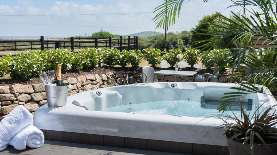 There's nothing better than luxuriating in the open air hot tub on a balmy evening and savouring the beauty of the surrounding coastal landscape.