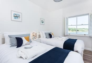 Twin bedroom with en suite shower room and sea views.