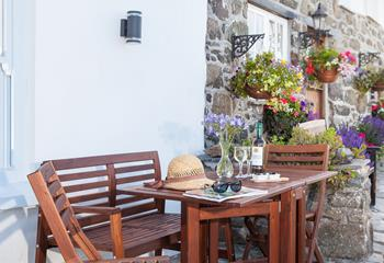 Patio table and bench to the front of Gunvor Cottage to enjoy the stunning views.