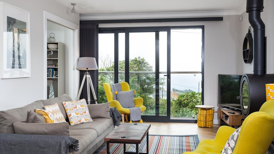 The interior decor and furnishings have been tastefully selected, the yellow armchairs provide a lovely burst of colour.