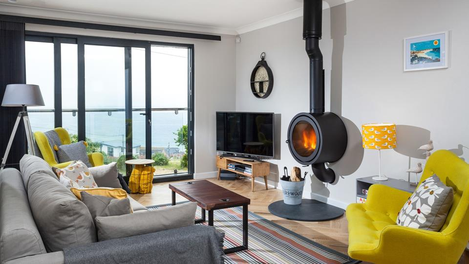 The living room has fantastic views over Porthmeor, you can slide open the sliding doors to reveal a private Juliette balcony and let the sea air in.