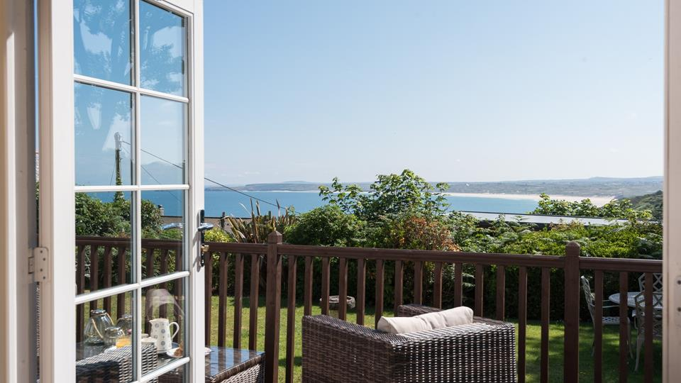 A picture-perfect view; the french doors from the living area lead to the private terrace with far-reaching sea views.