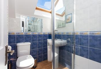 Light and airy shower room with skylight.