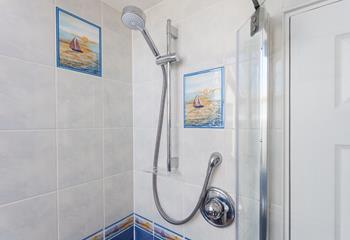 The shower in the shower room.