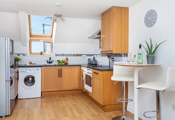 Snug modern open plan sitting/dining/kitchen area.