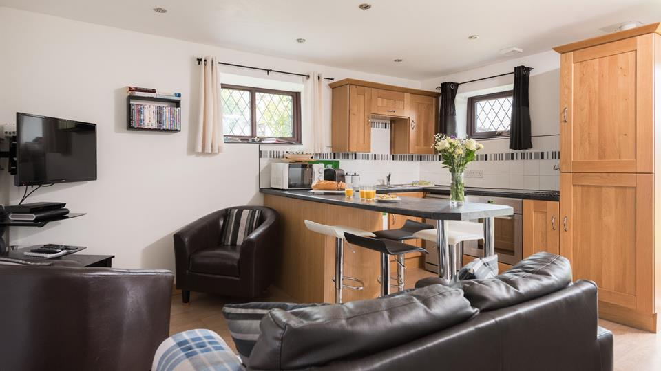 The open plan living area and kitchen form the sociable hub of the house.