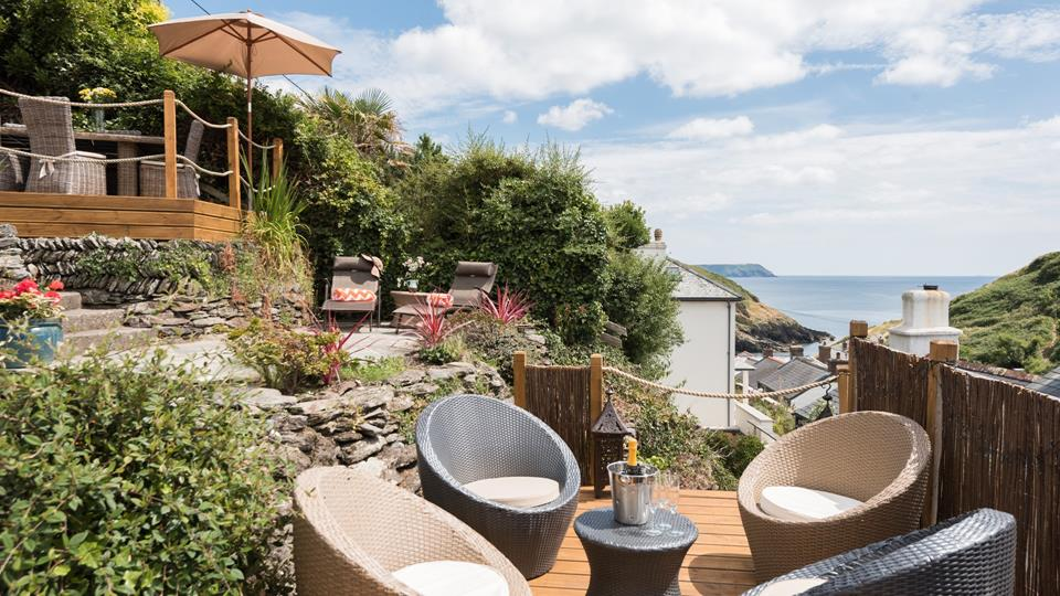 Arrive at Rose Cottage and indulge in a glass of bubbly on the lower terrace, gazing out at the outstanding views.