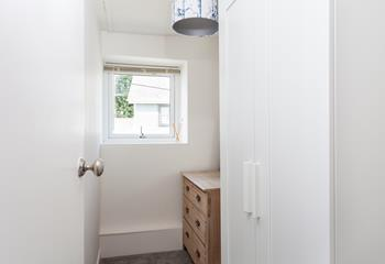 The spacious dressing room adjoining the bedroom has plenty of storage for your holiday outfits.