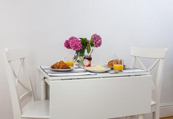 The dining table has enough space for a meal for two, but folds out if you need a little bit more space for your dishes.